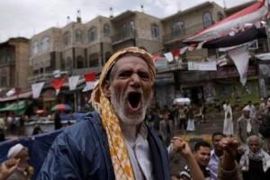 An elderly anti-government protester shouts slogans during a demonstration demanding the resignation of Yemeni president Ali Abdullah Saleh in Sana'a. Hani Mohammed STR